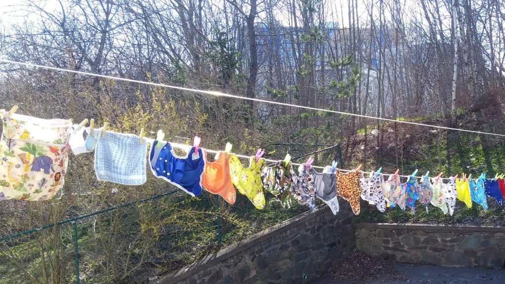 cloth diapers hung on a clothesline