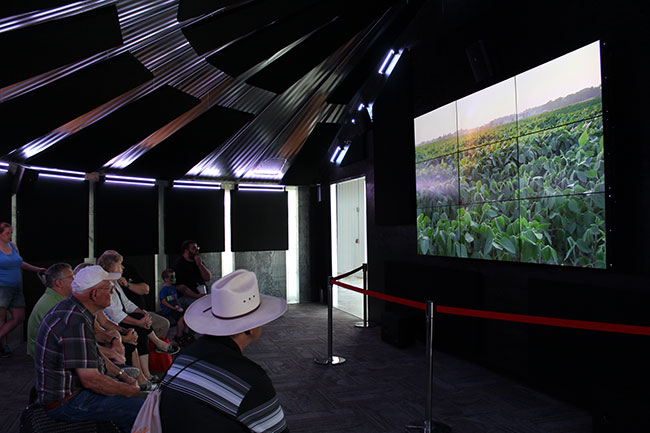 Visitors watch a six-minute video on agriculture in Nebraska.