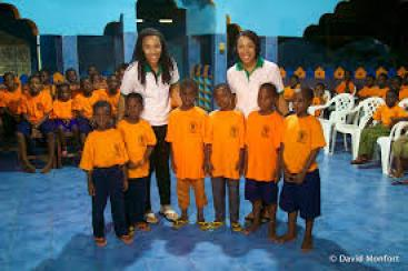 Trina and Tina Fletcher with orphans in Benin-West Africa