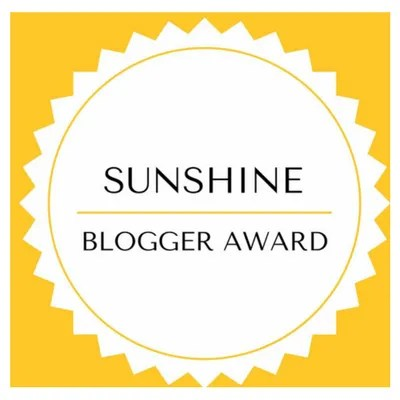 The Sunshine Blogger Award logo.
