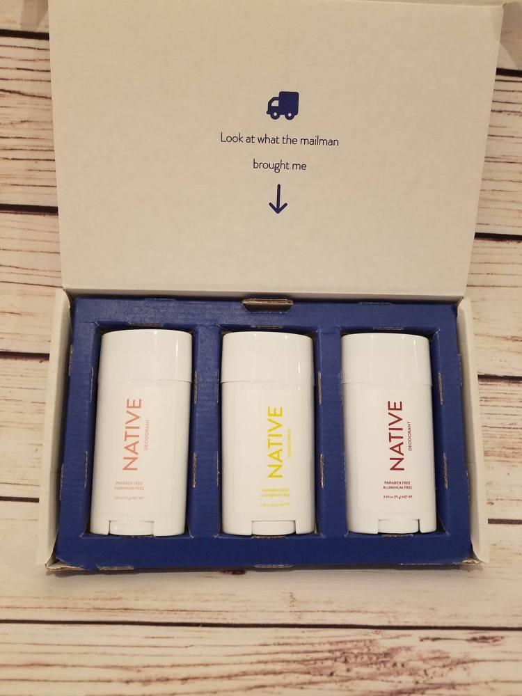 Three pack of Native Deodorant on wood table