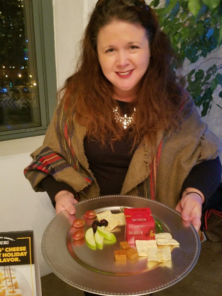 Woman holding cheese board