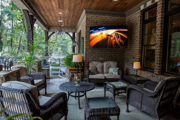 Outdoor TV mounted outside in deck area.