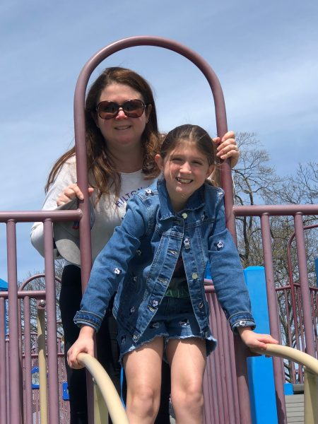 Mother and daughter on a playground gym.