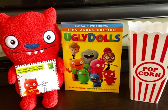 UglyDolls sing along edition Blu-ray, plushie, and popcorn container.