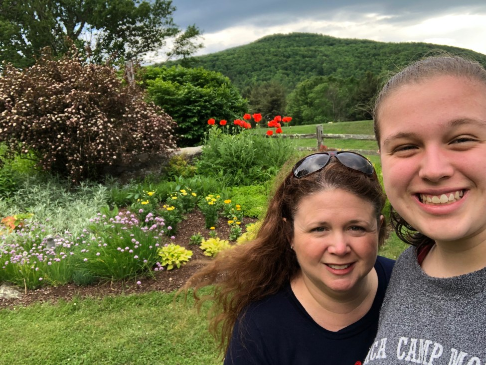 Mother and daughter with a garden and Great Northern Catskills mountains in background.