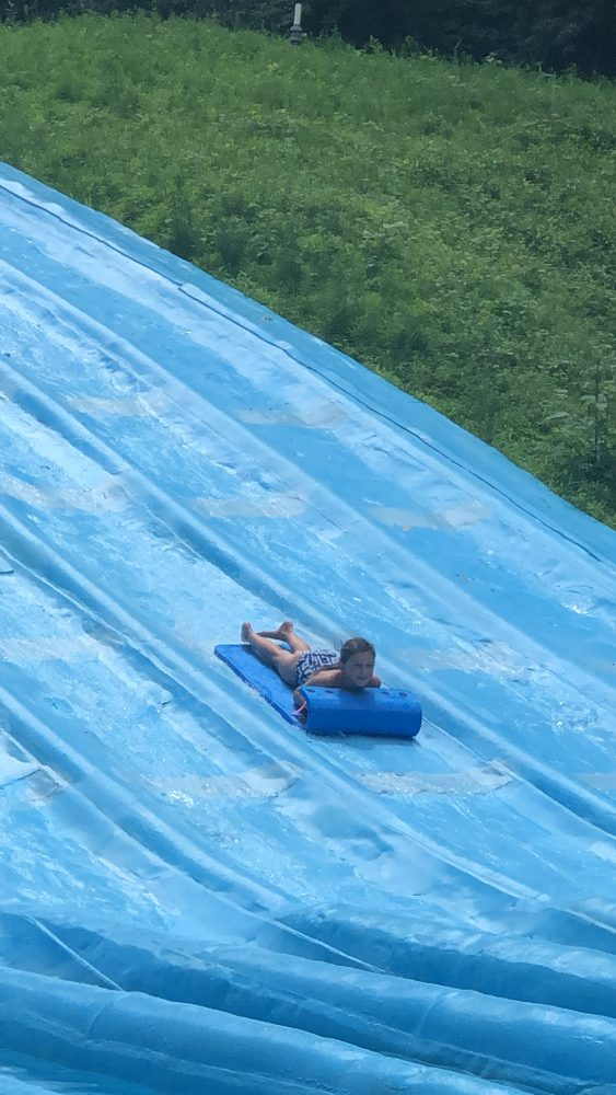 Girl going down a giant water slide.
