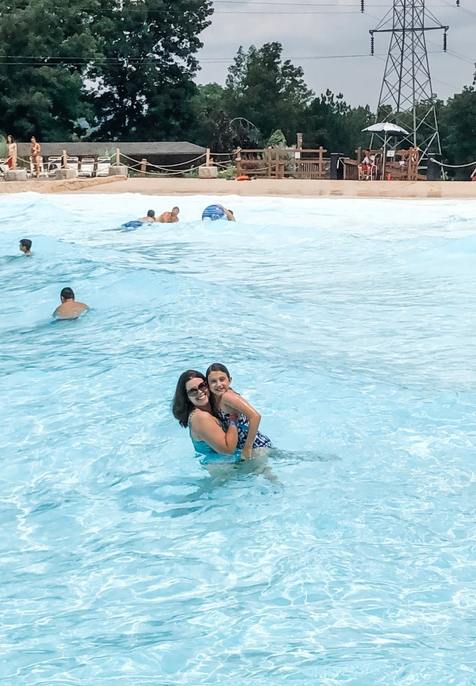 Mother and daughter in wave pool.