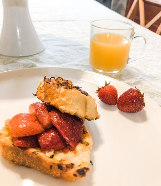 Grilled French toast with berries on plate