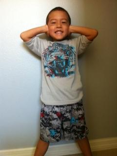 Boy wearing goodnites under pajamas