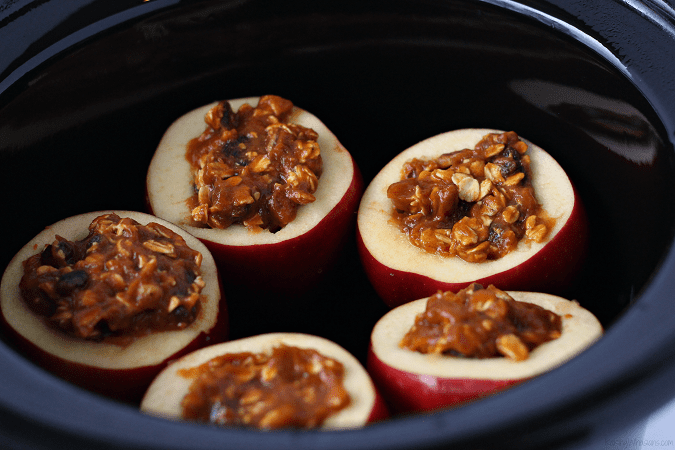 Easy fall pumpkin pie dessert with a healthy twist! No Guilt Slow Cooker Pumpkin Stuffed Apples Crock Pot Recipe is clean eating inspired & gives back - This slow cooker dessert is an easy make ahead recipe for any event. #Recipe #Dessert #SlowCooker