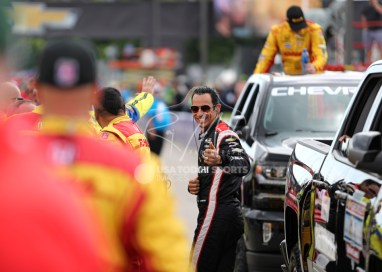 Jun 5, 2016; Detroit, MI, USA; Team Penske driver Helio Castroneves (3) of Brazil smiles before the Chevrolet Dual in Detroit Race 2 at The Raceway at Belle Isle Park. Mandatory Credit: Raj Mehta-USA TODAY Sports