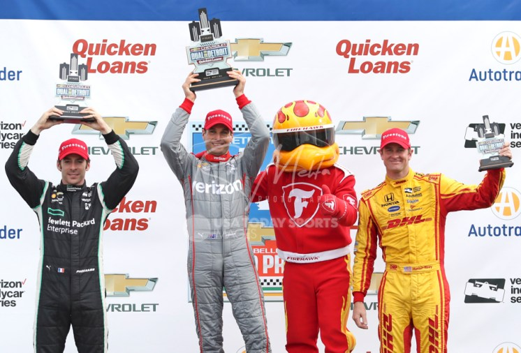 Jun 5, 2016; Detroit, MI, USA; (Left to right) Team Penske driver Simon Pagenaud (second place) of France and Team Penske driver Will Power (first place) of Great Britain and Andretti Autosport driver Ryan Hunter-Reay (third place) of United States raise their trophies after the Chevrolet Dual in Detroit Race 2 at The Raceway at Belle Isle Park. Mandatory Credit: Raj Mehta-USA TODAY Sports