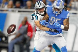 Oct 8, 2017; Detroit, MI, USA; Detroit Lions tight end Eric Ebron (85) drops a pass in the endzone against Carolina Panthers free safety Colin Jones (42) during the first quarter at Ford Field. Mandatory Credit: Raj Mehta-USA TODAY Sports