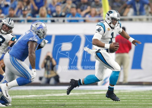 Oct 8, 2017; Detroit, MI, USA; Carolina Panthers quarterback Cam Newton (1) runs away from Detroit Lions defensive tackle A'Shawn Robinson (91) during the first quarter at Ford Field. Mandatory Credit: Raj Mehta-USA TODAY Sports