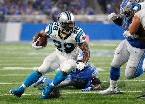Oct 8, 2017; Detroit, MI, USA; Carolina Panthers running back Jonathan Stewart (28) runs the ball past Detroit Lions strong safety Tavon Wilson (32) during the second quarter at Ford Field. Mandatory Credit: Raj Mehta-USA TODAY Sports