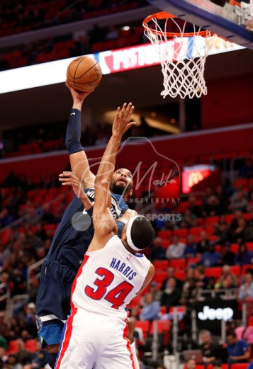 Oct 25, 2017; Detroit, MI, USA; Minnesota Timberwolves forward Taj Gibson (67) takes a shot over Detroit Pistons forward Tobias Harris (34) during the first quarter at Little Caesars Arena. Mandatory Credit: Raj Mehta-USA TODAY Sports