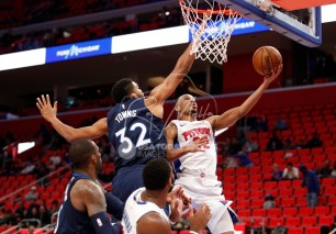 Oct 25, 2017; Detroit, MI, USA; Detroit Pistons guard Avery Bradley (22) goes up for a shot against Minnesota Timberwolves center Karl-Anthony Towns (32) during the third quarter at Little Caesars Arena. Mandatory Credit: Raj Mehta-USA TODAY Sports