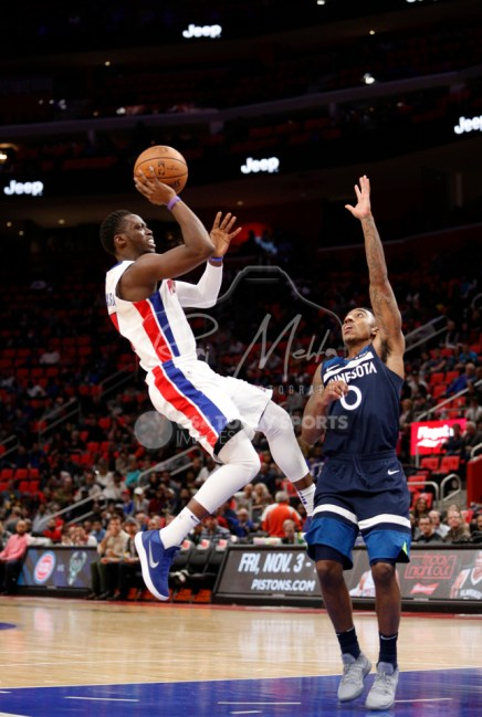 Oct 25, 2017; Detroit, MI, USA; Detroit Pistons guard Reggie Jackson (1) takes a shot over Minnesota Timberwolves guard Jeff Teague (0) during the third quarter at Little Caesars Arena. Mandatory Credit: Raj Mehta-USA TODAY Sports