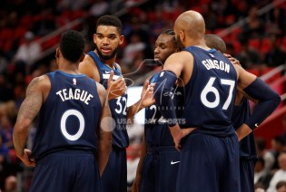 Oct 25, 2017; Detroit, MI, USA; Minnesota Timberwolves center Karl-Anthony Towns (32) guard Jeff Teague (0) forward Taj Gibson (67) guard Andrew Wiggins (22) and guard Jamal Crawford (behind) talk in a huddle during the fourth quarter against the Detroit Pistons at Little Caesars Arena. Mandatory Credit: Raj Mehta-USA TODAY Sports