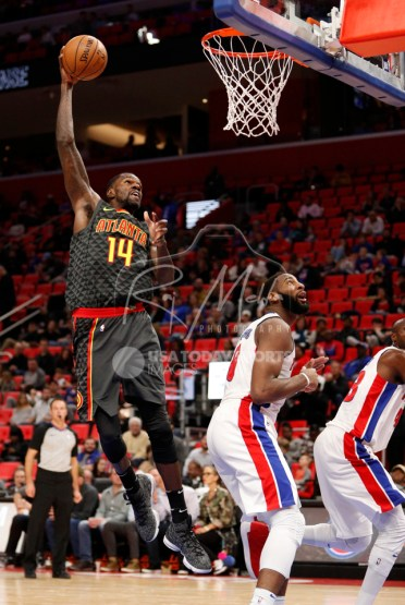 Nov 10, 2017; Detroit, MI, USA; Atlanta Hawks center Dewayne Dedmon (14) attempts a shot over Detroit Pistons center Andre Drummond (0) during the fourth quarter at Little Caesars Arena. Mandatory Credit: Raj Mehta-USA TODAY Sports