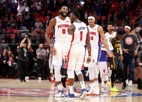 Nov 10, 2017; Detroit, MI, USA; Detroit Pistons guard Reggie Jackson (1) celebrates with center Andre Drummond (0) and forward Tobias Harris (34) after making a three point basket during the fourth quarter against the Atlanta Hawks at Little Caesars Arena. Mandatory Credit: Raj Mehta-USA TODAY Sports