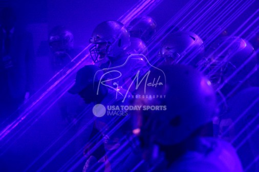 Nov 23, 2017; Detroit, MI, USA; Detroit Lions strong safety Don Carey (cap) and center Travis Swanson (64) lead the team through the laser beams in the tunnel before the game against the Minnesota Vikings at Ford Field. Mandatory Credit: Raj Mehta-USA TODAY Sports