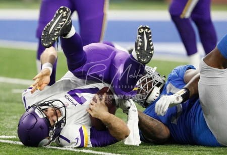 Nov 23, 2017; Detroit, MI, USA; Minnesota Vikings quarterback Case Keenum (7) gets tackled by Detroit Lions defensive tackle A'Shawn Robinson (91) during the second quarter at Ford Field. Mandatory Credit: Raj Mehta-USA TODAY Sports