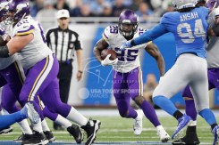 Nov 23, 2017; Detroit, MI, USA; Minnesota Vikings running back Latavius Murray (25) runs the ball during the second quarter against Detroit Lions defensive end Ezekiel Ansah (94) at Ford Field. Mandatory Credit: Raj Mehta-USA TODAY Sports