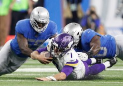 Nov 23, 2017; Detroit, MI, USA; Minnesota Vikings quarterback Case Keenum (7) dives in between Detroit Lions outside linebacker Tahir Whitehead (59) and linebacker Jarrad Davis (40) during the second quarter at Ford Field. Mandatory Credit: Raj Mehta-USA TODAY Sports