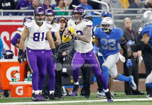 Nov 23, 2017; Detroit, MI, USA; Minnesota Vikings tight end Kyle Rudolph (82) runs after a catch during the second quarter against Detroit Lions strong safety Tavon Wilson (32) at Ford Field. Mandatory Credit: Raj Mehta-USA TODAY Sports