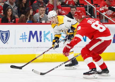 Feb 20, 2018; Detroit, MI, USA; Nashville Predators center Kyle Turris (8) skates with the puck against Detroit Red Wings defenseman Trevor Daley (83) during the first period at Little Caesars Arena. Mandatory Credit: Raj Mehta-USA TODAY Sports