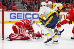 Feb 20, 2018; Detroit, MI, USA; Detroit Red Wings goaltender Jimmy Howard (35) makes a save against Nashville Predators left wing Filip Forsberg (9) and center Ryan Johansen (92) during the first period at Little Caesars Arena. Mandatory Credit: Raj Mehta-USA TODAY Sports
