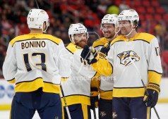 Feb 20, 2018; Detroit, MI, USA; Nashville Predators left wing Scott Hartnell (17) celebrates with center Nick Bonino (13) defenseman Ryan Ellis (4) and defenseman Roman Josi (59) after scoring a goal during the first period against the Detroit Red Wings at Little Caesars Arena. Mandatory Credit: Raj Mehta-USA TODAY Sports