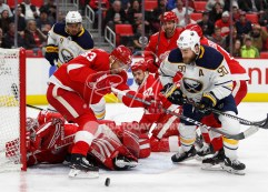 Feb 22, 2018; Detroit, MI, USA; Buffalo Sabres center Ryan O'Reilly (90) and Detroit Red Wings defenseman Trevor Daley (83) look for the puck in a crowd as goaltender Jimmy Howard (35) protects the net during the first period at Little Caesars Arena. Mandatory Credit: Raj Mehta-USA TODAY Sports