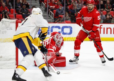 Feb 20, 2018; Detroit, MI, USA; Detroit Red Wings goaltender Jimmy Howard (35) makes a save against Nashville Predators left wing Scott Hartnell (17) during the first period at Little Caesars Arena. Mandatory Credit: Raj Mehta-USA TODAY Sports