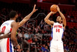 Feb 14, 2018; Detroit, MI, USA; Detroit Pistons guard Ish Smith (14) takes a shot over Atlanta Hawks guard Malcolm Delaney (5) during the first quarter at Little Caesars Arena. Mandatory Credit: Raj Mehta-USA TODAY Sports