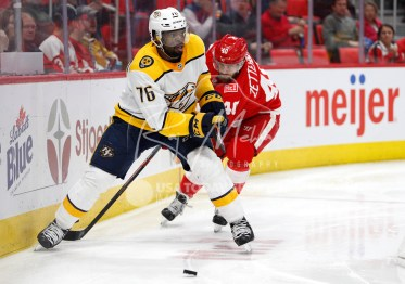 Feb 20, 2018; Detroit, MI, USA; Nashville Predators defenseman P.K. Subban (76) skates with the puck against Detroit Red Wings center Henrik Zetterberg (40) during the second period at Little Caesars Arena. Mandatory Credit: Raj Mehta-USA TODAY Sports