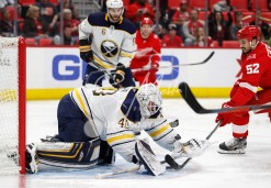 Feb 22, 2018; Detroit, MI, USA; Buffalo Sabres goaltender Robin Lehner (40) makes a save against Detroit Red Wings defenseman Jonathan Ericsson (52) during the second period at Little Caesars Arena. Mandatory Credit: Raj Mehta-USA TODAY Sports