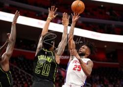 Feb 14, 2018; Detroit, MI, USA; Detroit Pistons forward Reggie Bullock (25) takes a shot over Atlanta Hawks forward John Collins (20) during the first quarter at Little Caesars Arena. Mandatory Credit: Raj Mehta-USA TODAY Sports