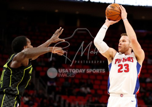 Feb 14, 2018; Detroit, MI, USA; Detroit Pistons forward Blake Griffin (23) takes a shot against Atlanta Hawks center Dewayne Dedmon (14) during the first quarter at Little Caesars Arena. Mandatory Credit: Raj Mehta-USA TODAY Sports