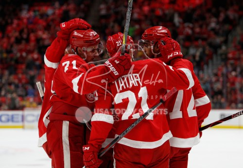 Feb 20, 2018; Detroit, MI, USA; Detroit Red Wings left wing Andreas Athanasiou (72) celebrates with left wing Tomas Tatar (21) and center Dylan Larkin (71) after scoring a goal during the second period against the Nashville Predators at Little Caesars Arena. Mandatory Credit: Raj Mehta-USA TODAY Sports