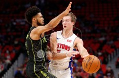 Feb 14, 2018; Detroit, MI, USA; Detroit Pistons guard Luke Kennard (5) passes the ball against Atlanta Hawks guard Tyler Dorsey (2) during the second quarter at Little Caesars Arena. Mandatory Credit: Raj Mehta-USA TODAY Sports