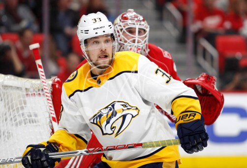 Feb 20, 2018; Detroit, MI, USA; Nashville Predators left wing Viktor Arvidsson (33) gets position in front of Detroit Red Wings goaltender Jimmy Howard (35) during the third period at Little Caesars Arena. Mandatory Credit: Raj Mehta-USA TODAY Sports