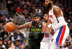 Feb 14, 2018; Detroit, MI, USA; Atlanta Hawks guard Malcolm Delaney (5) dribbles the ball against Detroit Pistons center Andre Drummond (0) during the third quarter at Little Caesars Arena. Mandatory Credit: Raj Mehta-USA TODAY Sports