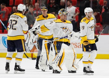 Feb 20, 2018; Detroit, MI, USA; Nashville Predators goaltender Juuse Saros (74) celebrates with center Ryan Johansen (92) after the game against the Detroit Red Wings at Little Caesars Arena. Mandatory Credit: Raj Mehta-USA TODAY Sports