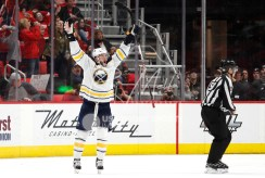 Feb 22, 2018; Detroit, MI, USA; Buffalo Sabres defenseman Marco Scandella (6) celebrates after scoring the game winning goal in overtime against the Detroit Red Wings at Little Caesars Arena. Mandatory Credit: Raj Mehta-USA TODAY Sports
