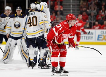 Feb 22, 2018; Detroit, MI, USA; Detroit Red Wings center Dylan Larkin (71) skates off the ice as Buffalo Sabres goaltender Robin Lehner (40) celebrates with teammates after the game at Little Caesars Arena. Mandatory Credit: Raj Mehta-USA TODAY Sports