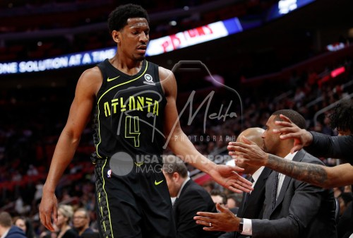 Feb 14, 2018; Detroit, MI, USA; Atlanta Hawks forward Andrew White III (4) celebrates with teammates against the Detroit Pistons during the fourth quarter at Little Caesars Arena. Mandatory Credit: Raj Mehta-USA TODAY Sports