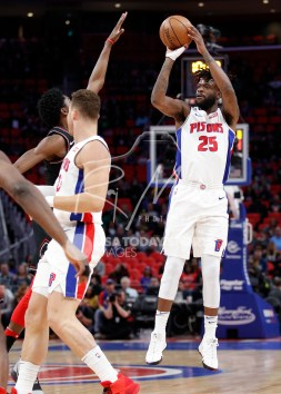 Mar 24, 2018; Detroit, MI, USA; Detroit Pistons guard Reggie Bullock (25) takes a shot during the first quarter against the Chicago Bulls at Little Caesars Arena. Mandatory Credit: Raj Mehta-USA TODAY Sports